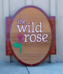 The Wild Rose - 3' x 4' sandblasted cedar, hand painted monument sign
